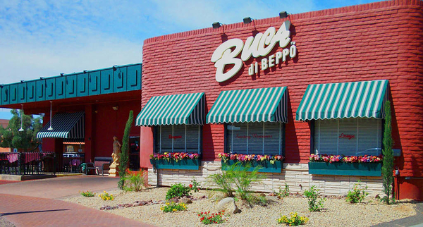 Exterior of a restaurant in daytime, where people hold Buca di Beppo fundraisers