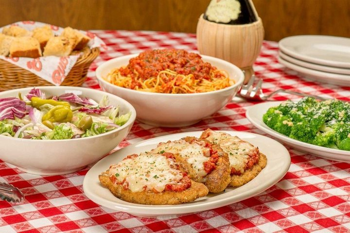 Four dishes of Italian food, all available at Buca di Beppo fundraisers