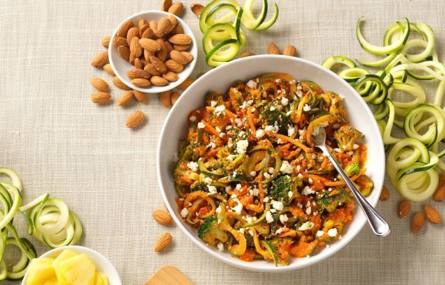 Spicy noodles with almond toppings, available at Noodles and Company fundraisers