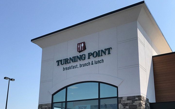 Exterior of a Turning Point restaurant during the day, where people can enjoy Turning Point fundraisers