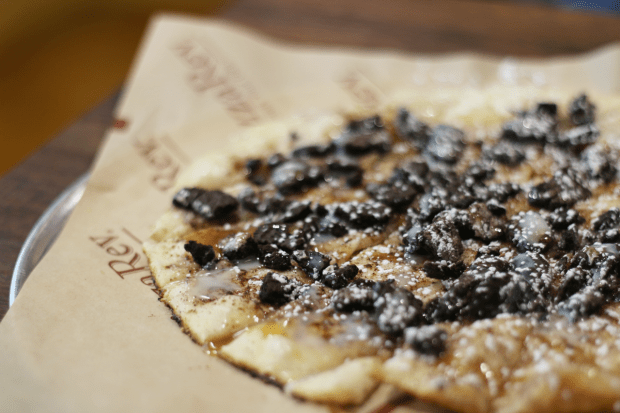 Close-up of dessert pizza with chocolate chips, found at Pizza Rev fundraisers