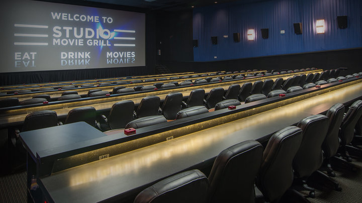 Movie theater and screen, where Studio Movie Grill fundraisers happen