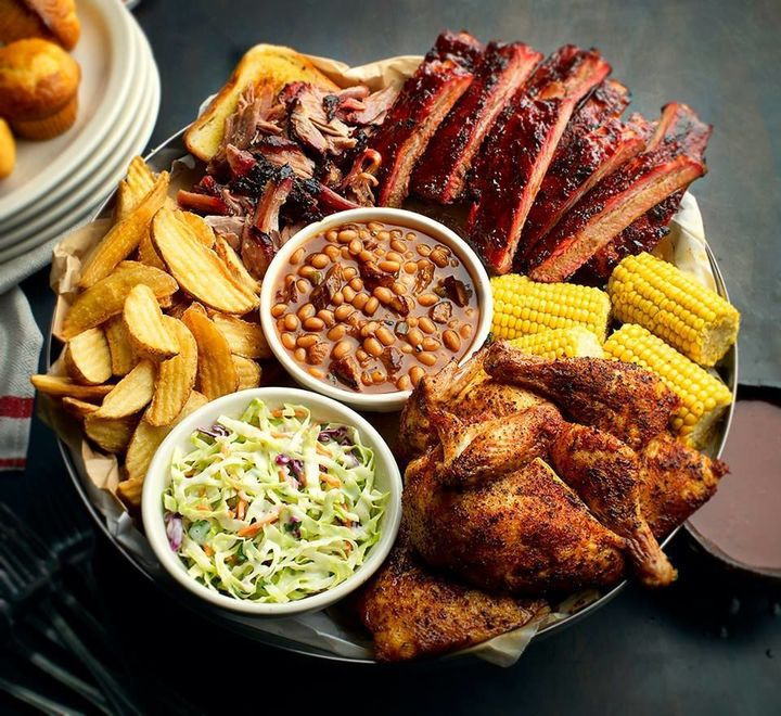Plate of barbecue meat, beans, and more, all available at Famous Dave's fundraisers