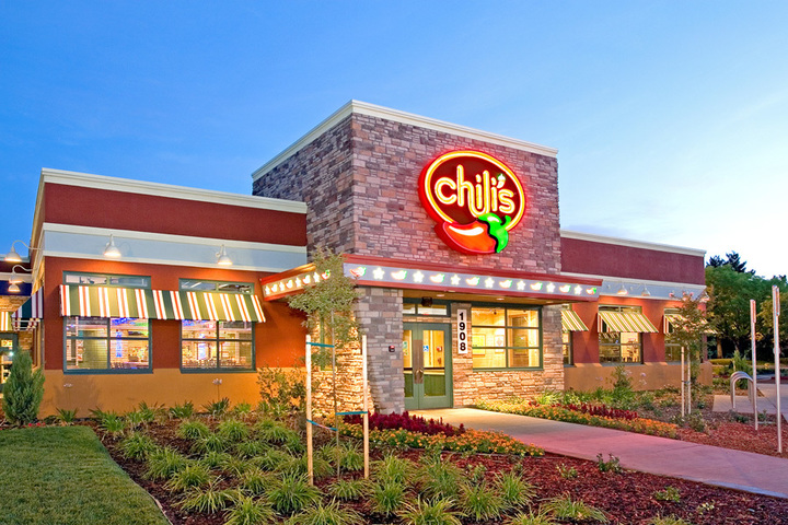 A Chili's location from the outside at dusk, where Chili's fundraisers happen