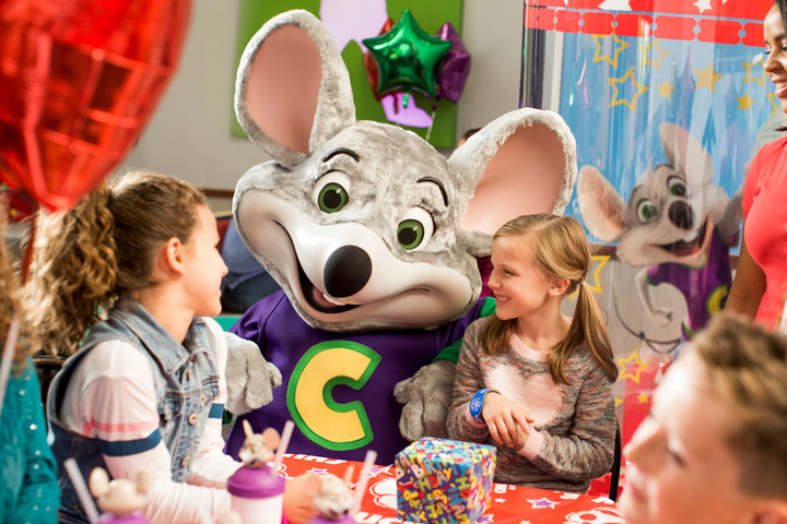 Two girls and a mouse mascot, found at Chuck E. Cheese's fundraisers