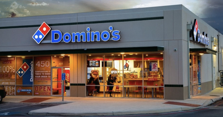 Domino's location from outside at night, where Domino's fundraisers happen