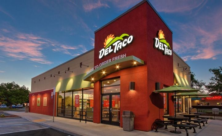 Exterior of a Del Taco location at dusk, where you can enjoy Del Taco fundraisers